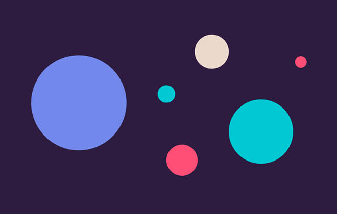 Circles of varying sizes and colours scattered on dark purple background