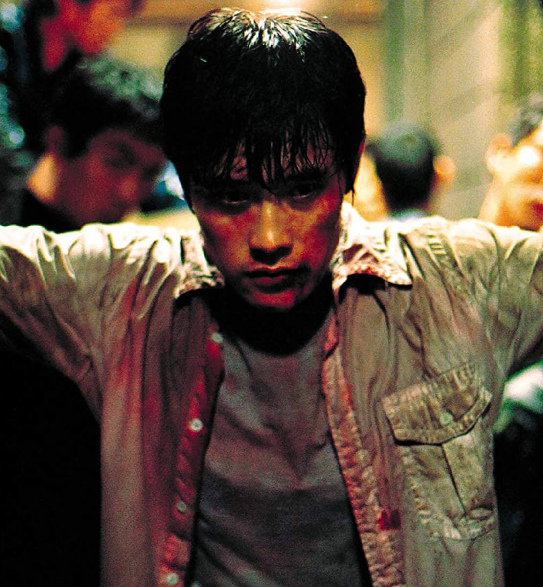 Shot from the film, depicting Sun-woo (Byung-hun Lee) standing bloodied and battered in a dark corridor