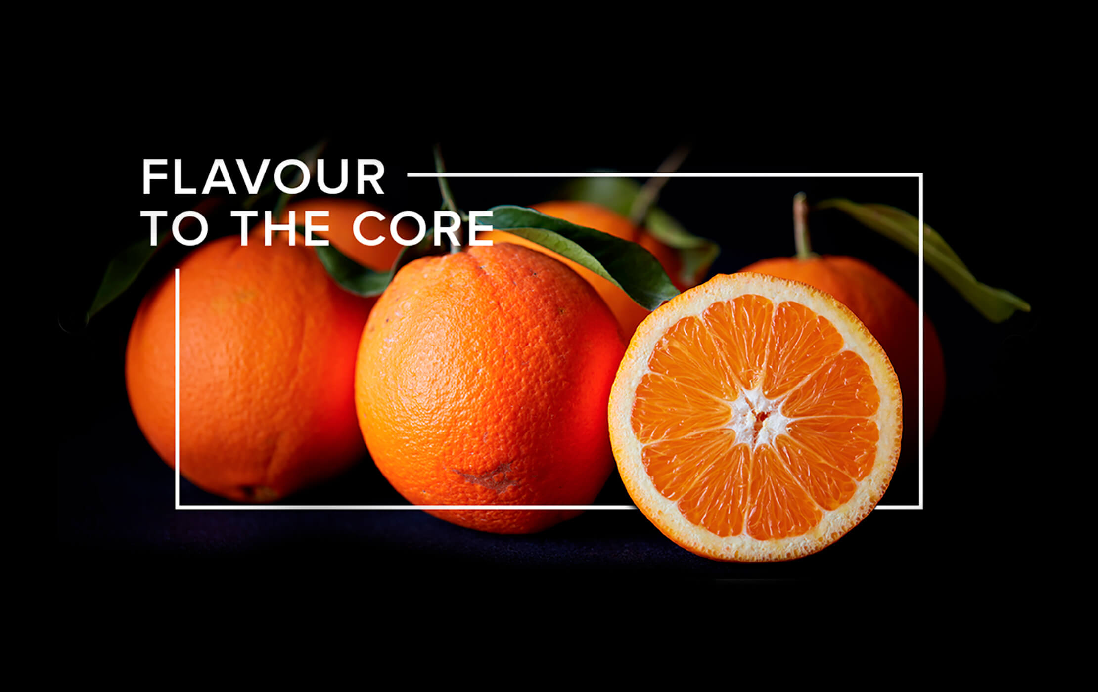 White 'Flavour to the Core' heading and rectangular frame on a black background, intertwined with oranges